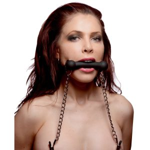 Tease your plaything with this dual featured silicone bit gag and nipple clamp set. Just affix the bit gag over the open mouth of your plaything