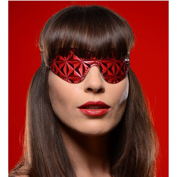 Enjoy the sexy contrast design of embossed black and red vinyl while your plaything experiences the sensations of sight deprivation. The blindfold itself is lined in a soft yet durable neoprene for a sensual and comfortable play session. The strap is made of a stretchable elastic material