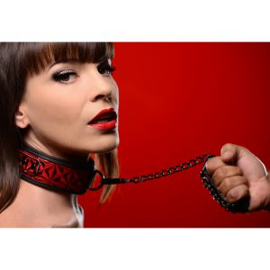 Allow yourself the freedom of relinquishing control with the Crimson Tied Leash and Collar Set from the Master Series. The collar features a sleek and sexy red and black embossed design