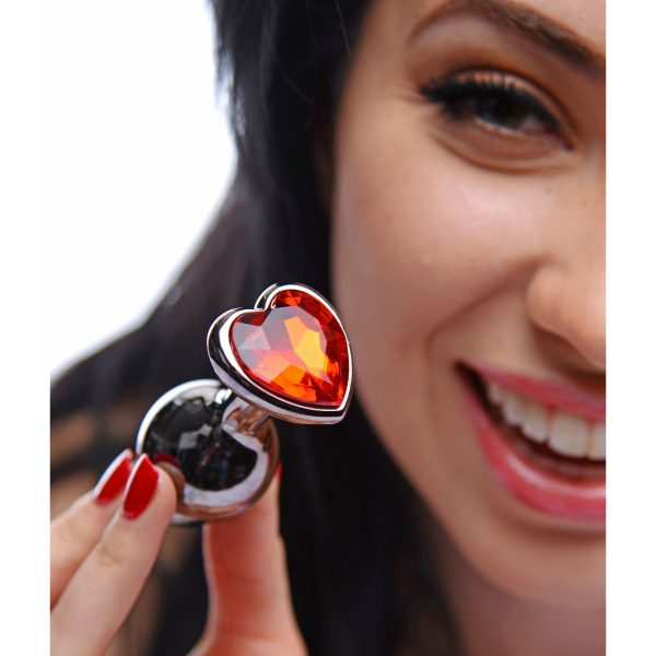 Surprise your lover and get your heart on with the Scarlet Jewel Anal Plug. This shiny metal butt plug has a classic shape and an endearing heart shaped jewel for stimulating and visually stunning anal play. Durable yet lightweight