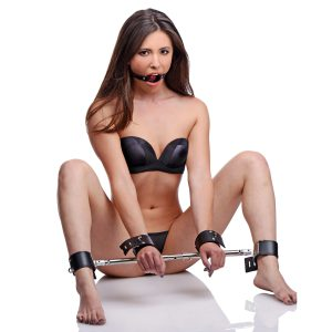 Secure their wrists and ankles and grant yourself unrestricted access to their mouth with this simple yet highly effective bondage kit. The cuffs are secured permanently to the bar