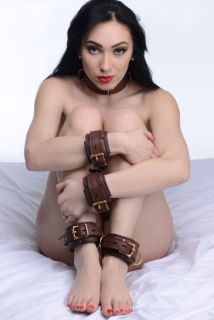 Restrain your lover in these luxurious leather cuffs and collar. This elegant set is designed to last through your most vigorous play sessions. Made of soft