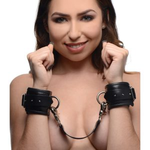 These bondage wrist cuffs will keep your submissive partner comfortably and safely confined while you live out your fantasies. The inner lining is genuine leather for the luxurious sensation against your lovers wrists