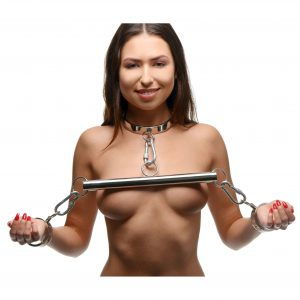 Take your bondage scenes to a fantasy realm where slaves are locked up in shackles for the amusement of their owners. This beautiful stainless steel yolk set includes sophisticated collar and cuffs with O-rings for attaching them to each other or other BDSM accessories. Each has a discreet and elegant pin-lock that opens and closes with a hex key. A connector bar and 3 carabiners create a yoke that will keep your partners hands up by their neck and out of your way as you play with their vulnerable body. The gleaming chrome is strikely attractive