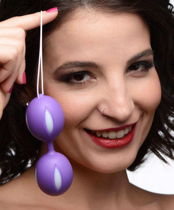 This Kegel ball set includes two bulbs of purple and white with rolling metal balls within each bulb for stimulation. Use these kegel balls to strengthen your pelvic floor! Insert and squeeze against the indented silicone ridges for a pleasurable training session.  Health professionals and sex experts around the world encourage exercising your pelvic floor with kegel balls to not only increase the intensity of your orgasms