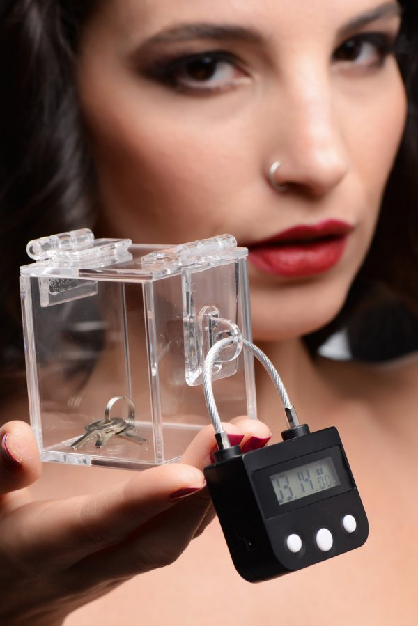 This transparent case puts your power dynamic on display! Created for those who dabble in extended BDSM scenes involving chastity and key holding – the see through design and countdown timer lock sets the stage for a long-term exchange in power and trust for kinky couples and BDSM enthusiasts. Lock up your sub in a chastity device or a pair of restraints and lock up the keys until they earn their freedom.  Explore a more decisive and extreme form of play with the included countdown lock – the left button sets the hour duration while the right button sets the minute duration. Once you press the middle button a 5 second countdown begins! During this countdown