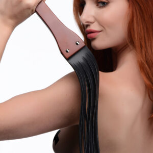 A Flogger fit for BDSM masters! This dungeon essential is a welcome addition to any collection - the thick ergonomic wooden handle is a joy to hold and makes it easy to manipulate the leather falls so you can punish your partner with just the right amount of sting.     Punish and please with the plush PU leather tassles - when your sub has been especially bratty