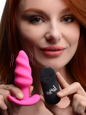 Enjoy the delicious swirling pattern of this Silicone Swirl butt plug! Plush and bumpy to provide a satisfying fill and an addictive mass for your ass to squeeze - perfect for use solo but can also be use with a lover to spice up your one on one time. Made with premium materials and equipped with a powerful motor for intense vibrations when needed!     Choose from 3 speeds and 7 patterns of vibrations to send down this twists anal plug! Choose which function fits your or your partners preference and enjoy this plug in tandem with other naughty activities. Flip through all functions with the base controls or with the included wireless controller.     Made with premium phthalate free silicone for a luxurious and body safe experience. The IPX5 water resistant build makes this plug easy to clean and safe for use in the shower. Compatible with water based lubricants only.     Recharge with the included USB charging cable when the power runs low for unlimited fun!      Measurements : Overall length 4.2 inches