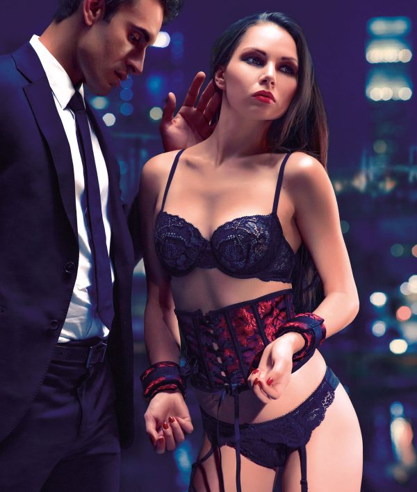 Delight your lover with the Scandal Corset with Cuffs! Your true beauty will shine in this red brocade corset and its matching cuffs – the gorgeous black lace-up closure and silky ribbon give a royal energy when worn