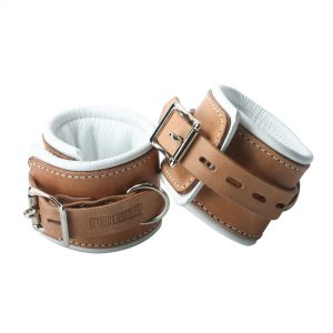 Lock your sub down in these stylish and comfortable Strict Leather Padded Hospital Style Cuffs. Made from high quality light brown leather with padding on the inside lined with white leather for superior comfort. Each set has 5 notches so you have a wide range to find the perfect fit. You can rest assure that when you place you sub in these cuffs