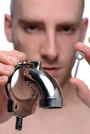 Handcuff your slaves desires with the Cock Cuff Chastity Device. This device is made from a stainless steel handcuff and has a steel tube welded to the front to make sure all pleasure is under your lock and key The opened end allows for use 24-7. The device comes with an L-shaped bar extending from the penis lock to halfway over the cage. Measurements: 3.5 inches in length