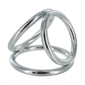 The Triad Chamber brings the art of domination in threes. This chrome cock cage features three differently sized O-rings with which you can ensnare your pet. The largest ring goes around the cock and balls like a normal cock ring. The middle sized ring goes around the balls