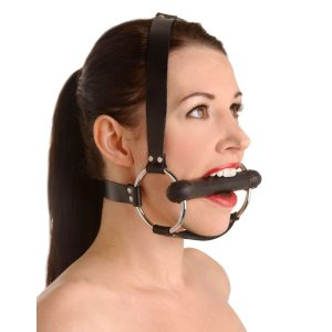 Saddle up With this Locking Trainer Gag made from silicone. This gag is perfect for those into pony play. This gag has a chin strap for extra support as well as straps that go behind and over the head. There are two locking buckles in the back to make sure your little pony does not run off. Once your sub is strapped in they will find this gag to be very comfortable and since the gag is made from silicone it has no odor or taste. Locks are not included with gag.