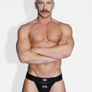 Wrap your package in gleaming black leather and look like a true Tom of Finland stud with this stretchy and hot leather jock strap The elastic waistband bears the Tom of Finland logo