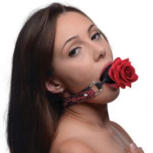Gag them with roses with this Full Bloom silicone ball gag! The sultry red and black lace strap is comfy and provides an enticing lingerie aesthetic on your subjects face as you enjoy the realistic rose blooming from their mouth. Adjustable and comfortable for long term wear and enjoyment for you and your play thing!     The silicone ball gag is silky smooth and phthalate free and body safe so you can play worry free