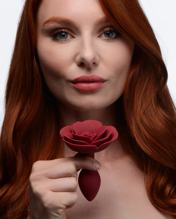 Decorate your derriere with this blooming anal plug rose! Crafted from velvety silicone and shaped with individual petals for a realistic and satisfying texture - the long neck and tapered tip make this plug easy to insert and comfortable to squeeze on